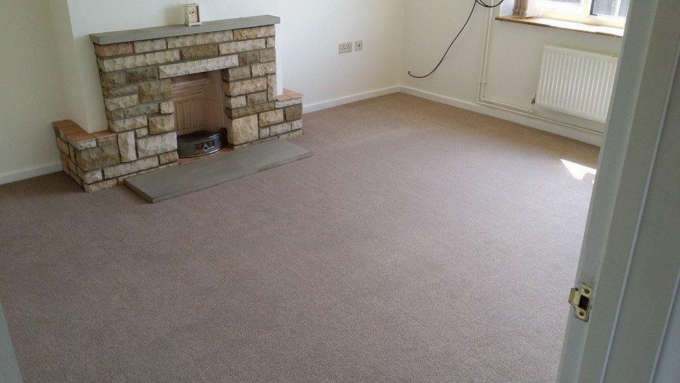 pale carpet fitted around fireplace