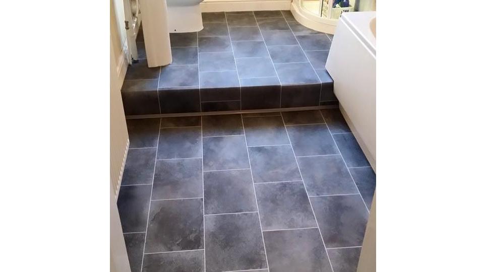 slate floor installed on stepped bathroom floor
