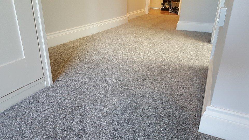 carpet layed in irregular shaped hallway