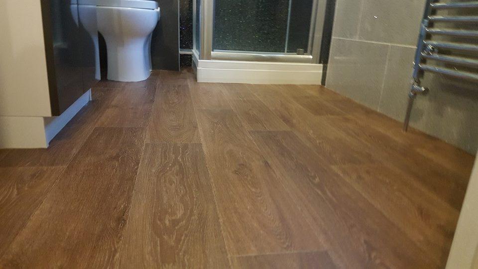 wood flooring in a small bathroom