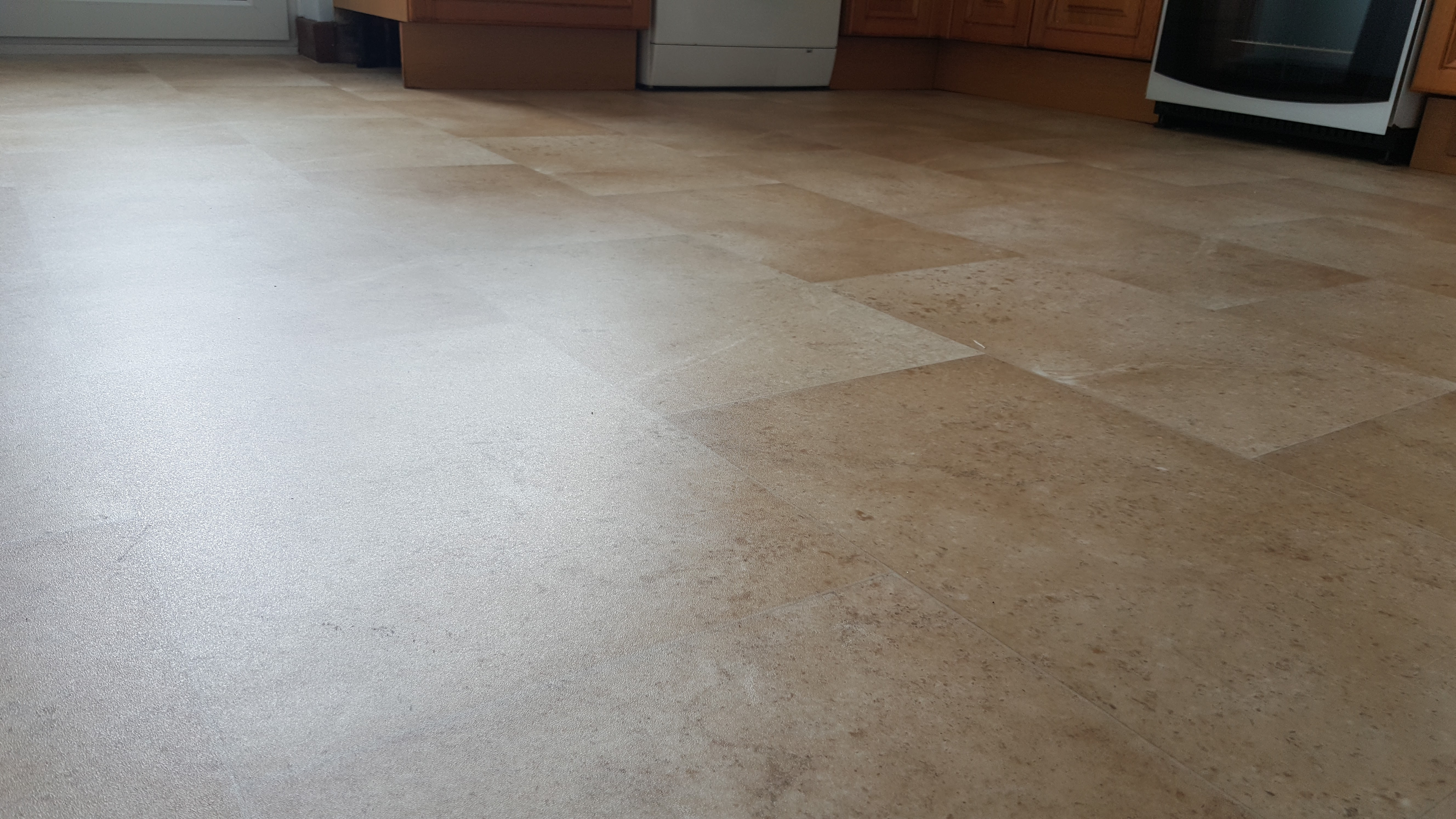 Light Terracotta Vinyl Flooring Fitted To A Kitchen In